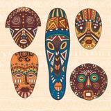 Set of five African masks Stock Photos