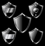 Set of five black steel shields Royalty Free Stock Photo