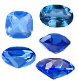Set of five blue sapphires on white Royalty Free Stock Image