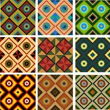 Set of five different colored geometric seamless patterns. Set of nine different colored geometric pattern of seamless squares, triangles and octagons Stock Photography