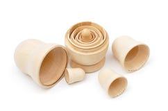 Set of five disassembled wooden matryoshkas Stock Photos