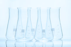 Set of five empty conical temperature resistant flasks Royalty Free Stock Photography