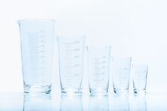 Set of five empty temperature resistant conical beakers Royalty Free Stock Images