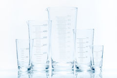 Set of five empty temperature resistant conical beakers of different size Stock Photo