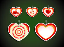 Set of five labels on dark background. Hearts Stock Image