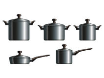 Set of five metal cooking pots Stock Photography