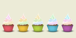 Set of five rainbow cupcakes Royalty Free Stock Photos
