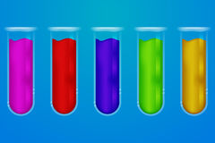 Set of five transparent glass chemical tubes with colorful fluid Stock Photography