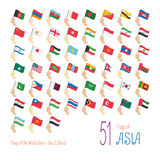 Set of 51 flags of Asia. Hand raising the national flags of 51 countries in Asia. Icon set Royalty Free Stock Photo
