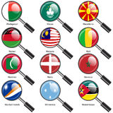 Set  Flags of world sovereign states magnifying glass. Royalty Free Stock Image