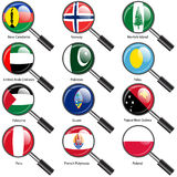 Set  Flags of world sovereign states magnifying glass. Royalty Free Stock Images