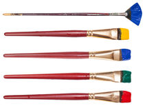 Set of flat artistic paintbrushes with painted tips Stock Photo