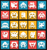 Set of flat 8 bit pixel art monsters Stock Images