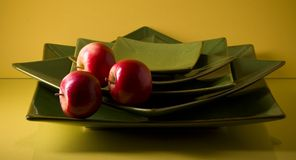 Set of flat ceramic plates and apples Royalty Free Stock Photo