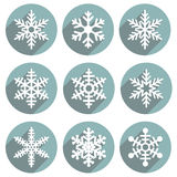 Set of flat colored simple winter snowflakes. Royalty Free Stock Photography