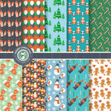 Set of flat design Christmas and New Year seamless patterns Royalty Free Stock Image