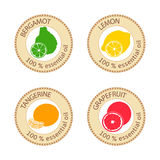 Set of flat essential oil labels. 100 percent. Bergamot, lemon, grapefruit, tangerine Stock Image