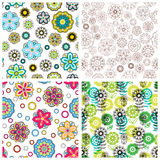 Set of floral backgrounds. Vector illustration. Set of seamless floral backgrounds. Seamless floral patterns with yellow, red, pink hand drawn doodle flowers stock illustration