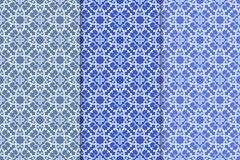 Set of floral ornaments. Blue vertical seamless patterns Stock Photos