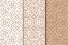 Set of floral ornaments. Brown, beige and white seamless patterns Stock Images
