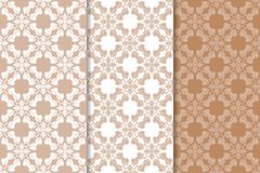 Set of floral ornaments. Brown, beige and white seamless patterns Stock Photography