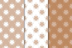 Set of floral ornaments. Brown, beige and white seamless patterns. For textile and wallpapers Stock Photography