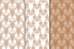 Set of floral ornaments. Brown, beige and white seamless patterns. For textile and wallpapers Stock Images