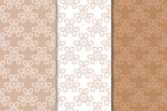Set of floral ornaments. Brown, beige and white seamless patterns. For textile and wallpapers Royalty Free Stock Image