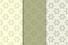 Set of floral ornaments. Olive green vertical seamless patterns Royalty Free Stock Images
