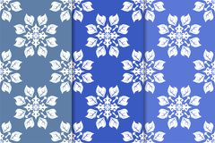 Set of floral ornaments. Vertical blue seamless patterns Stock Photos