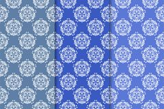 Set of floral ornaments. Vertical blue seamless patterns Stock Photo
