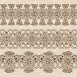 Set of floral seamless ornaments. Decorative borders. Grunge background Stock Image