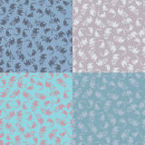Set of floral seamless patterns. Set of four hand drawn folkloric floral seamless patterns in pastel tones Stock Image