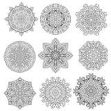 Set of 9 flower mandalas. Hand drawn design elements. Vector. Stock Images