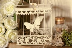 Set of flowers cage and stones as decoration stock images