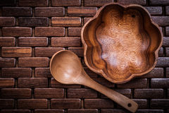 Set of flowershaped wood bowl and spoon on wooden matting Stock Image