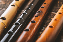 Set of flutes  on the wooden table horizontal Royalty Free Stock Photo