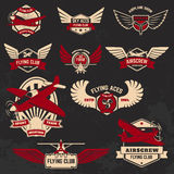 Set of flying club labels and emblems on grunge background. Stock Photos