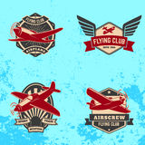 Set of flying club labels and emblems on grunge background. Stock Photo