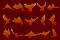 Set of flying fire red doves on dark red background Royalty Free Stock Photo