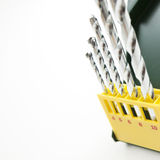 Set fo drills in a green box. On white isolated background Stock Image