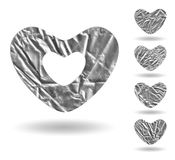 Set of foil hearts on white. Set of hearts on white, made of gray crumpled foil royalty free illustration