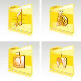 Set of folders with abstract icons for computer. Or smart phone. Music, video, games, photo Royalty Free Stock Images
