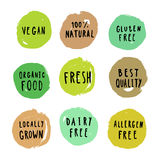 Set of food badges. Vegan, gluten, etc. Set of food badges. Vegan gluten dairy free, fresh, organic, locally grown, best quality. Vector hand drawn signs Royalty Free Stock Images