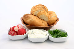 Set of food ingredients. Rollbread put together with choped redish, tzatziki and parsley Royalty Free Stock Photos