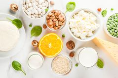 Set of food rich in calcium. Healthy food concept. Set of food rich in calcium - dairy and vegan Ca products, white marble background top view copy space Stock Images
