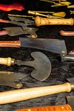 Set of forged kitchen hatchets with a wooden handle semi-circular traditional shape a wide blade on a dark base stock photography