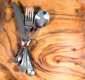 Set of fork, spoon and knife on wooden background Royalty Free Stock Photo