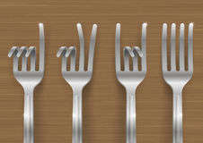 Set of forks bent in the form of gestures. Set of metal forks bent in the form of gestures. Concept on a theme of meal Royalty Free Stock Images