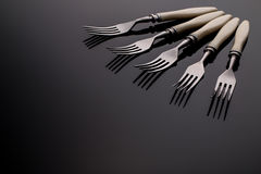 Set of forks. Five  pieces.  On  gray background Royalty Free Stock Photo